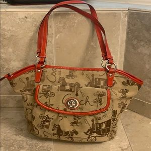 Coach shoulder bag brown with red leather detail.